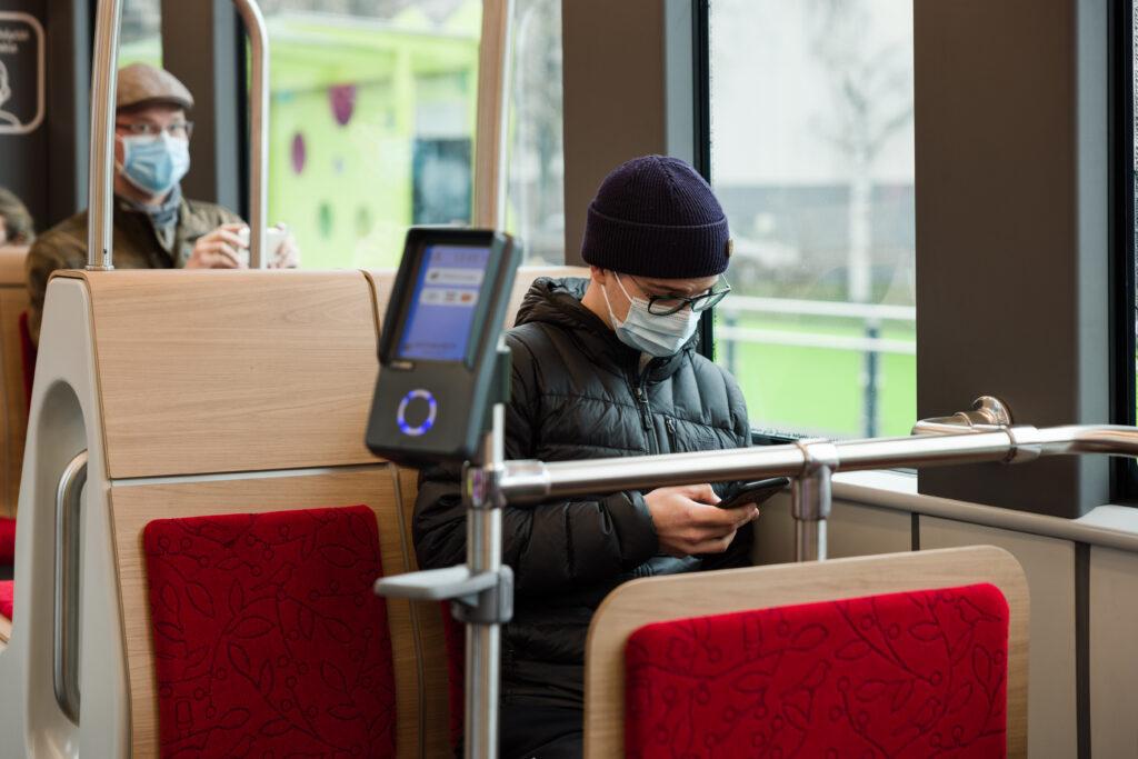 Passengers sitting inside the tram.